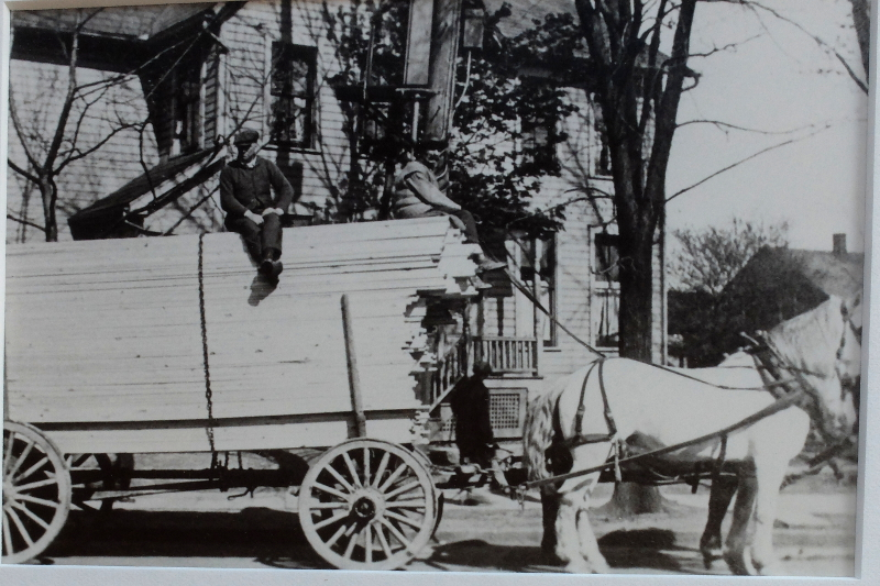 Lumberyard deliveries by horse and buggy in the early 1900s